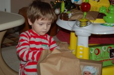 Opening his gifts.