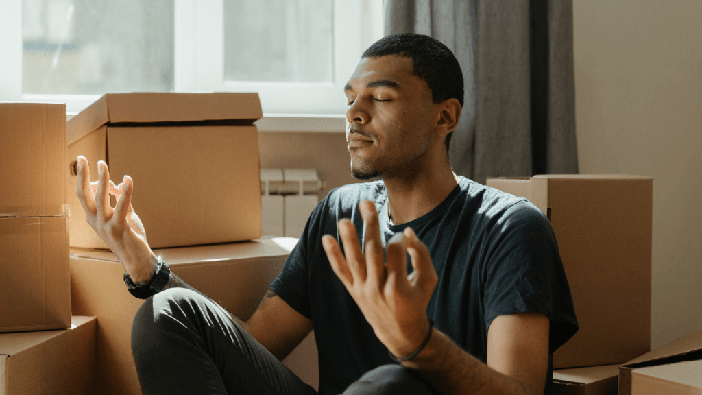 Become a yogi by connecting with your breath like this man meditating surrounded by boxes