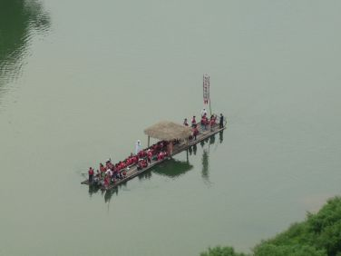 A boat with people in traditional attire