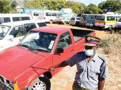 Policeman shows impounded vehicles