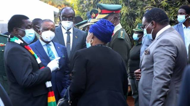 President Mnangagwa speaks to Defence and War Veterans Affairs Minister Oppah Muchinguri-Kashiri and Zimbabwe Defence Forces Commander General Philip Valerio Sibanda (partly obscured) when he consoled the late national hero Cde Perrance Shiri's family in Borrowdale, last week, in the company of Vice Presidents Constantino Chiwenga (second from left) and Kembo Mohadi. - Picture: Believe Nyakudjara
