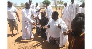 Madzibaba Emmanuel Mutumwa praying for some of Highlanders officials at his shrine