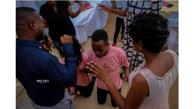 Prophet Panashe and partner being blessed at an engagement