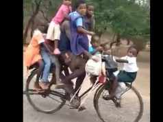 Malawian cyclist Mavuto Mussa, who was arrested in Chikwawa outside Blantyre for transporting nine pupils on his bicycle to a nursery school. Screengrab from video shared on Twitter