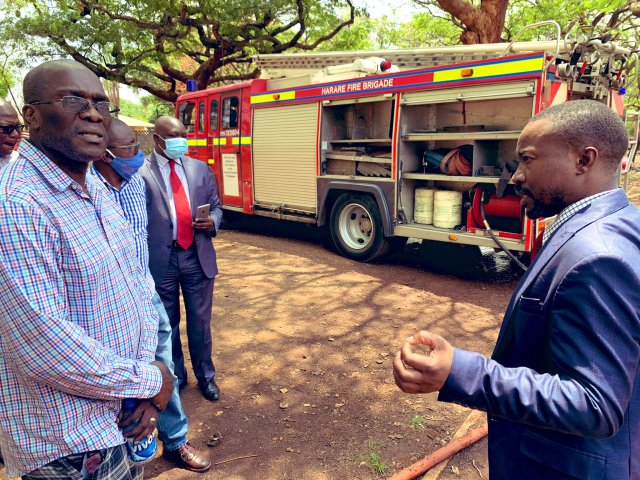 Harare Mayor jacob Mafume(right) on the scene today. with an empty Fire truck in the background