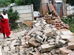 File Photo: Mrs Promise Ncube stands close to the spot where her child Nkosiphile was crushed by rubble after a precast wall collapsed in Surbubs,Bulawayo.