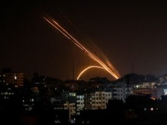 Illustrative: Rockets are fired from the Gaza Strip toward Israel, on November 13, 2019. (Anas Baba/AFP)
