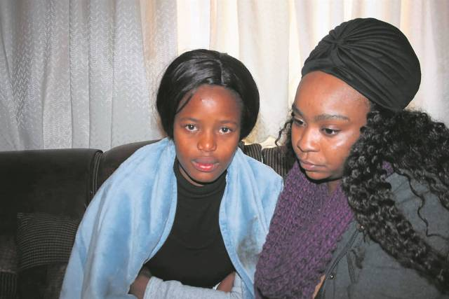 GRIEVING: Atlegang's girlfriend Nqobile Mdlalose and his older sister, Lethabo Mohlala, mourn his death. Atlegang Selepe (inset) was shot dead. Photo by Phineas Khoza.