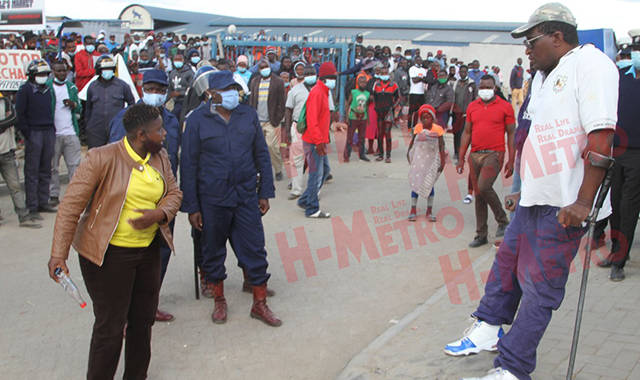 King Irie confronted the clamp down team led by municipal police when they reached his stall.