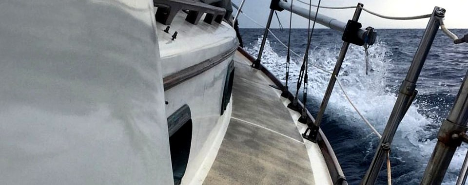 A fragment of a small Cape Dory 30 sailing boat traveling around the world - the art of sailing