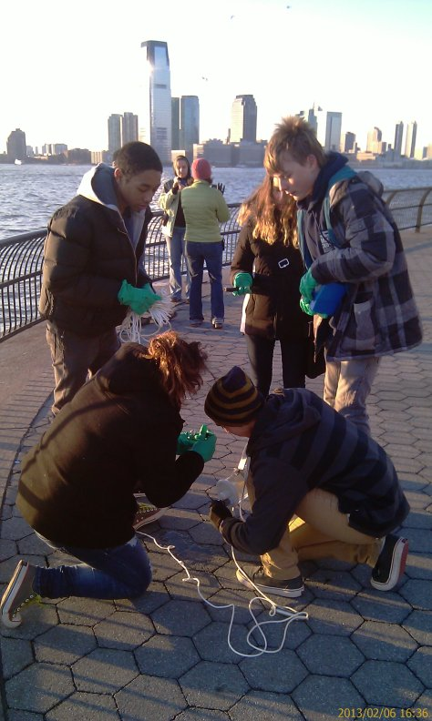 Team M1 of the Harbor SEALs sampling water quality in Manhattan