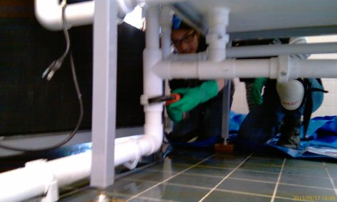 Jade and Tahirah remove the plumbing from our recirculating system to prepare it for its move to the greenhouse.