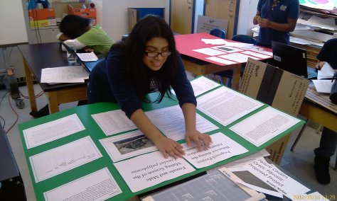 Kimberly MOrales working on her poster display.