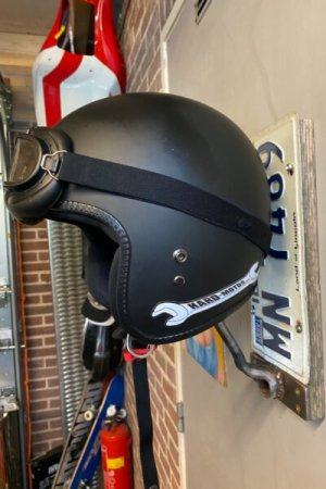 Handmade Helmet Holder – A wrench on a board keeps your helmet safely stored