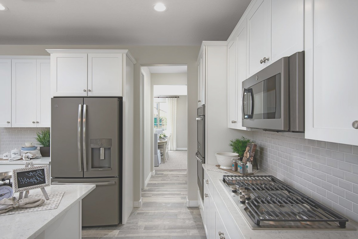 Slate Appliances With White Cabinets