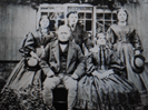 George Milburn his wife and children outside Rectory Cottage