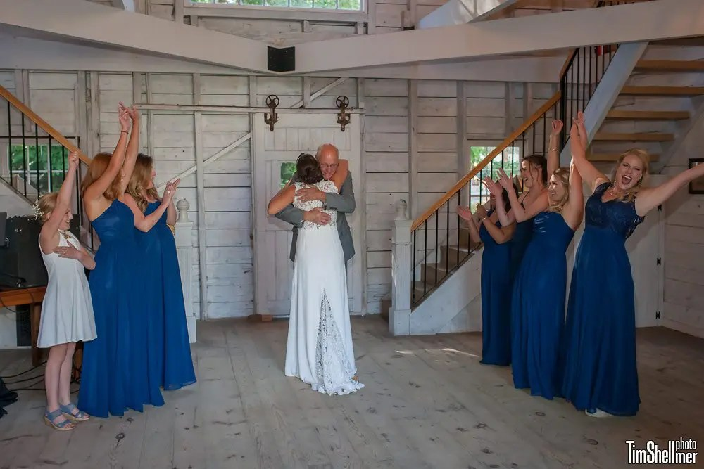 Father daughter embrace at Maine Barn wedding