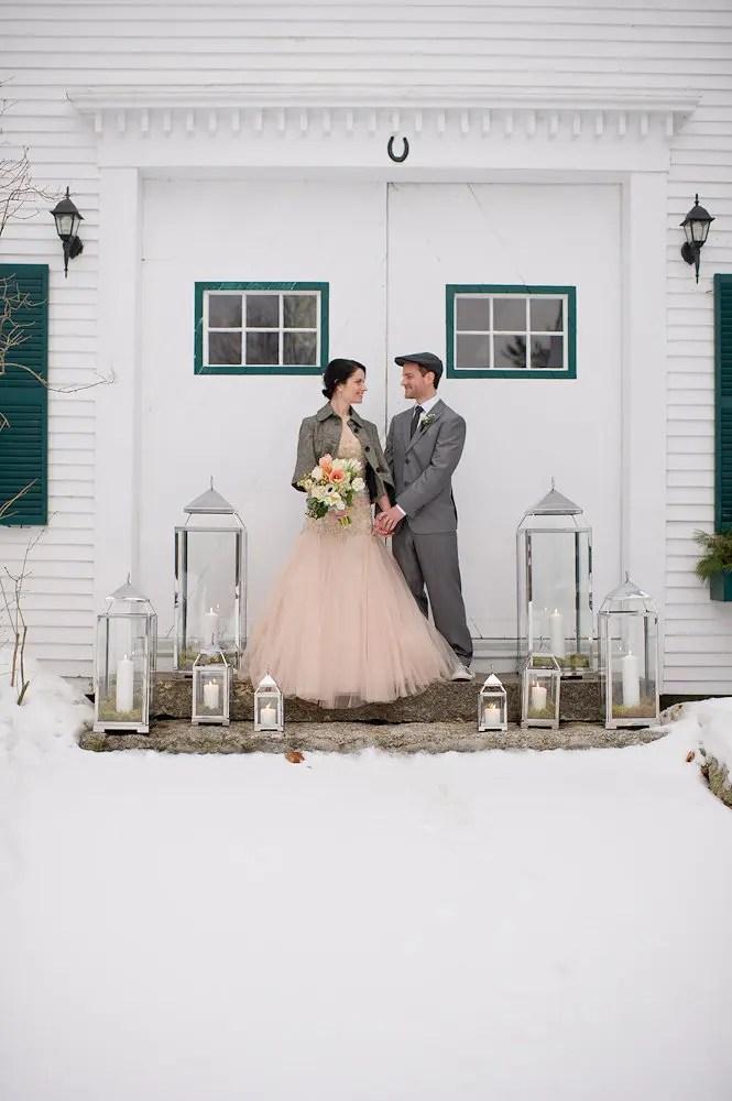 Winter wedding photo with lanterns