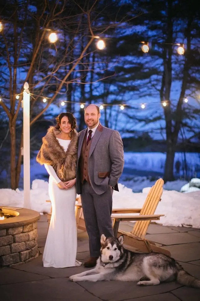 Winter wedding by the firepit with their dog