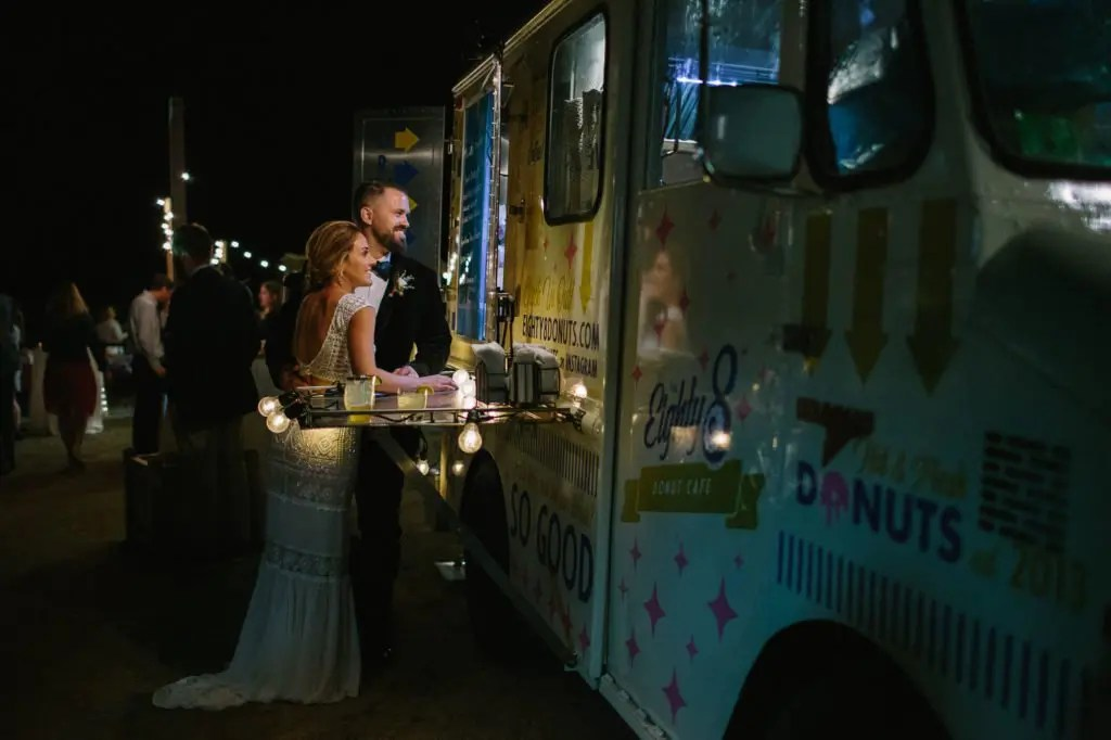 Donut food truck with bride and groom
