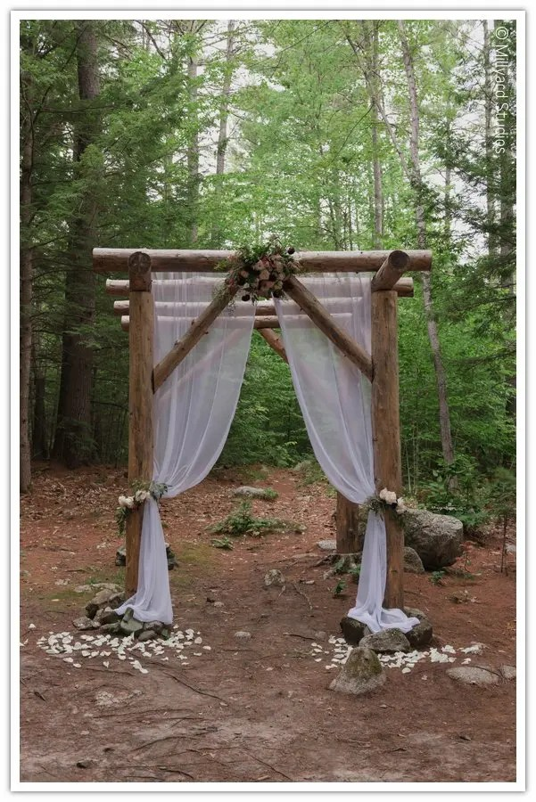 Flower and draping ideas at woodland chapel