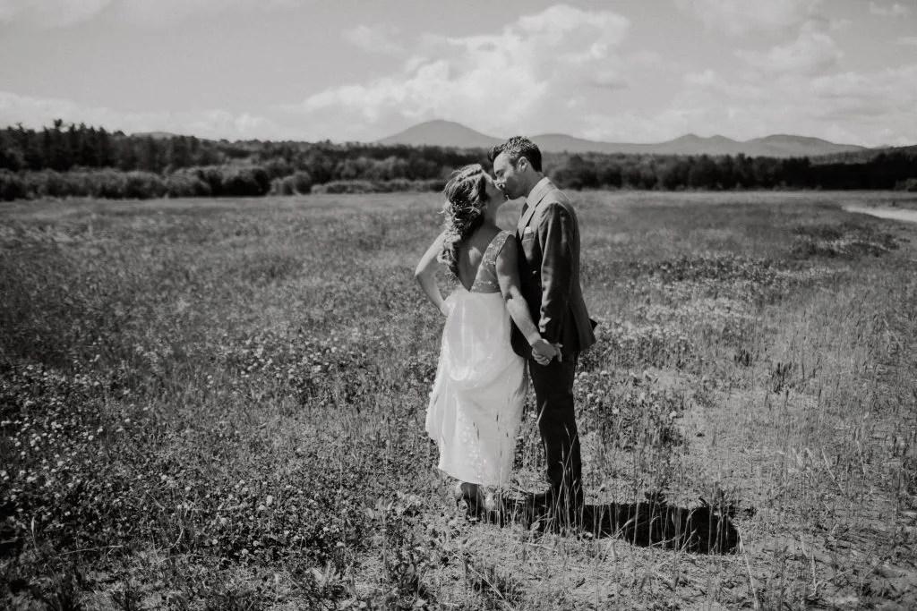 wedding kiss in beautiful Maine field