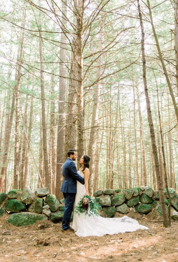 Beautiful shot of wedding couple in the Maine woods