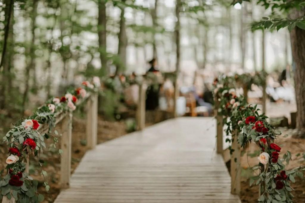 Beautiful walkway into woods wedding ceremony
