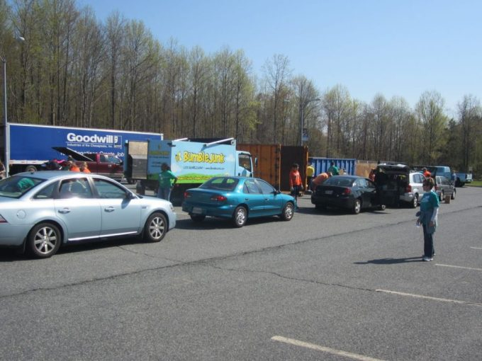 Cars line up to unload unwanted items to various collection groups during the 2014 Clear Your Clutter Day.