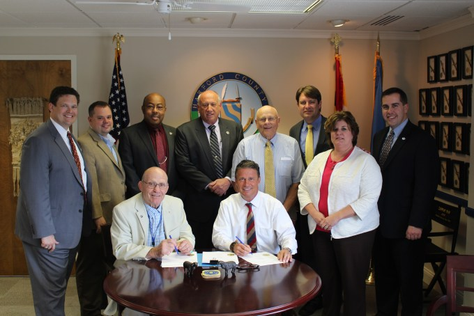 """Photo caption: Seated, L to R: Council President Richard C. Slutzky, County Executive Barry Glassman Standing, L to R: County Treasurer Robert F. Sandlass, Councilman Joe Woods, Councilman Curtis L. Beulah, Councilman Patrick S. Vincenti, Councilman James """"Capt'n Jim"""" McMahan, Councilman Chad Shrodes, County Budget Chief Kimberly K. Spence, Councilman Mike Perrone Jr."""