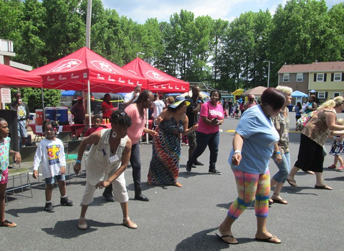 HDGHA residents and attendees of Summer Jam learn line dances during the event.