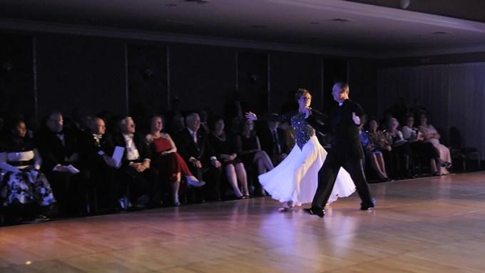 """One of the 2014 """"celebrity"""" dancers, attorney Karmen Slezak, takes to the floor with dance coach Tom Rzepnicki."""