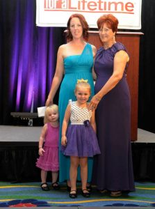 Jessica, a former client of Harford Family House, stands with her children and the organization's executive director, Joyce Duffy, at the Bird's Ball. Jessica shared the story of how Harford Family House changed her life in a video broadcast during the event.
