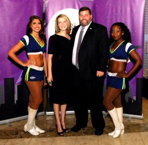 Harford County Director of Housing and Community Development Len Parrish and his wife Andrea pose with Bay Hawks' cheerleaders at the Harford Family House Bird's Ball on August 29. The charity event raised $64,000 to help the homeless of Harford County.