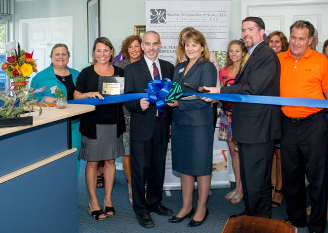 Shaffer, McLauchlin & Stover partners Brad Stover, Gina Shaffer and Eric McLauchlin (front row, center) were surrounded by friends and family during the September 23 ribbon-cutting ceremony to officially open the firm's new office in Ocean City, Maryland. Front row, left to right: Terri Mahoney, Melanie Pursel and Greg Newman; Back row, left to right: Melissa McSorley, Joya Mattie and Ginger Fleming.