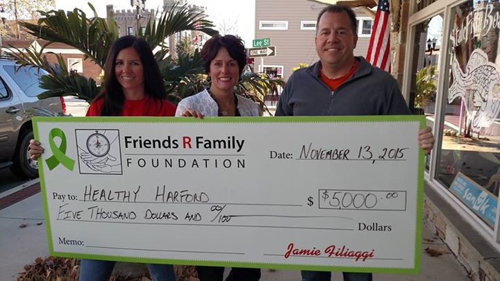 Sharon Lipford (center), executive director of Healthy Harford, accepts a $5,000 grant from the Friends R Family Foundation to promote suicide prevention in Harford County. The grant was presented by Kathy Walsh, treasurer/secretary of Friends R Family Foundation (left), and Jamie Filliagi, president, Friends R Family Foundation. (Photo courtesy of Friends R Family Foundation)