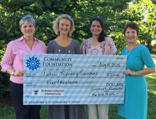 Kim Malat, Grants Committee chair of the Women's Giving Circle of Harford County (left), and Jodi Davis, chair (right), present a $5,000 grant to Emily Emerick, executive director of Ladew Topiary Gardens, and Sheryl Pedrick, education  director at Ladew, for a young botanist program. (Photo Courtesy of the Women's Giving Circle of Harford County)