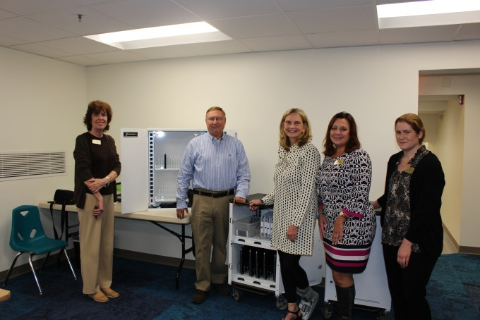 Miles Konopka, president/owner of Interactive Communications Research, Inc., presents two discovery carts to Beth LaPenotiere, manager, Bel Air Library (left); Mary Hastler, CEO, Harford County Public Library; Kristi Halford, foundation director, Harford County Public Library; and Jenny Novacescu, assistant branch manager, Bel Air Library. (Photo courtesy of Harford County Public Library)