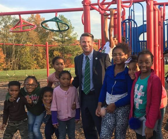 Harford County Executive Barry Glassman visiting with students in the after-school program re-established by his administration at the Edgewood Recreation and Community Center. Pictured from left: Daniel, Skye, Brionah, Megan, Randi (above Megan), County Executive Glassman, Ronni (on playground equipment), Zianna, Trinaty, Asjah