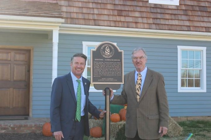 County Executive Barry Glassman, left, and preservationist and author C. John Sullivan Jr. celebrating the rededication of Harford County's historic Joesting-Gorsuch House. Saved from demolition by the Glassman administration, the centuries-old house was disassembled at its original location in Bel Air and reassembled on county-owned property in Street, Md.