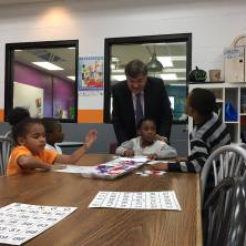 Congressman Ruppersberger peeks in on a lively game of BINGO in the Learning Center.