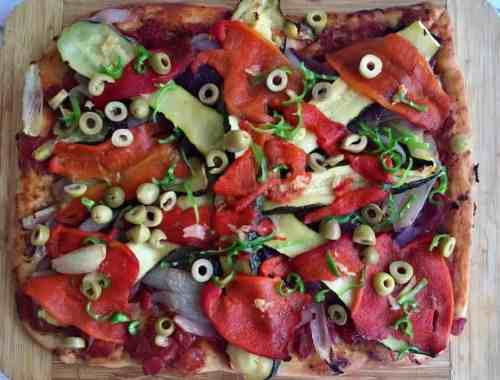vegan pizza on chopping board