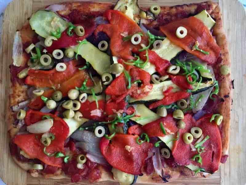 vegan pizza on chopping board