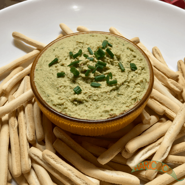 bowl of hummus with coriander and lime