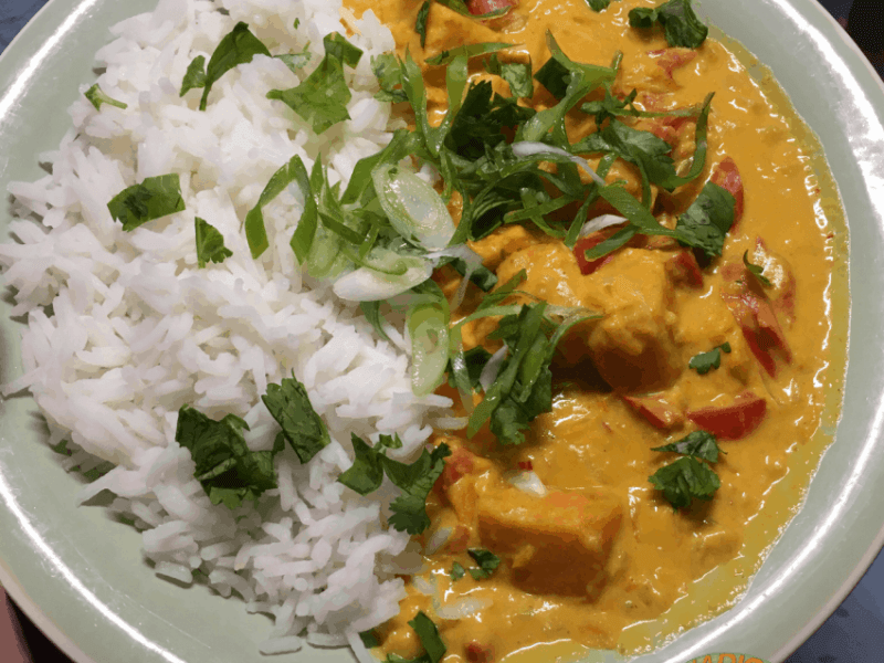 sweet potato curry with rice on a plate