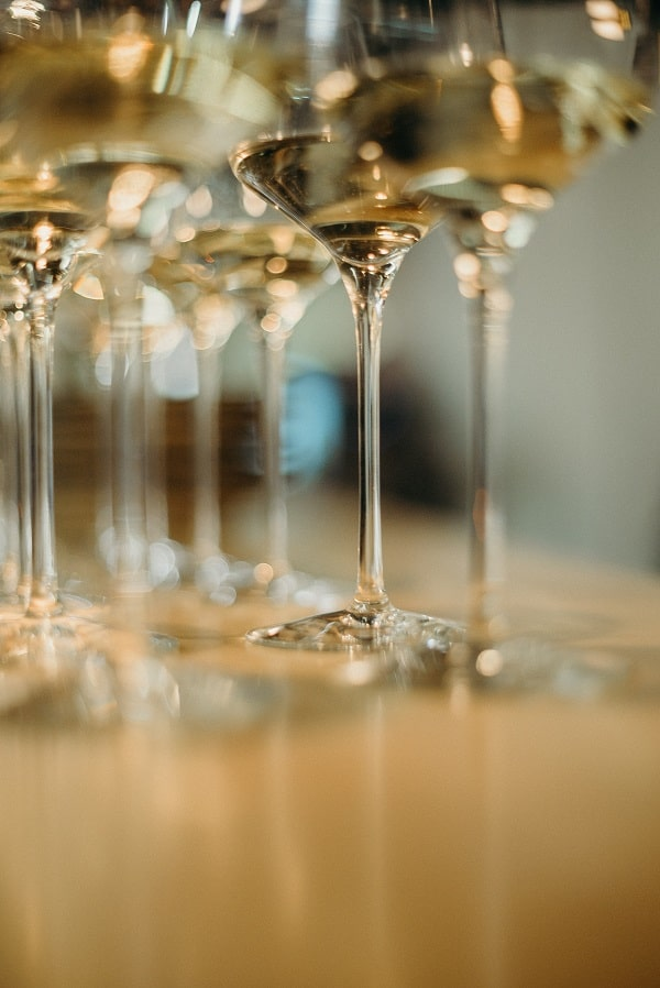 decorative glasses of white wine