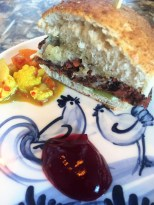 Juice Pulp Burger, re-purposed bread bun, waste picalli, beetroot runoff ketchup & waste fed bacon