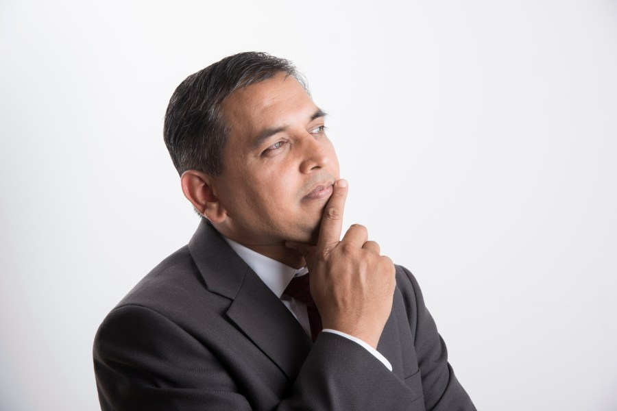 indian handsome businessman in thinking pose