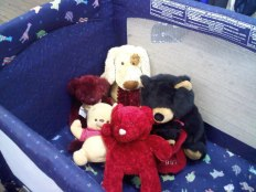 Portable Crib with Stuffed Friends