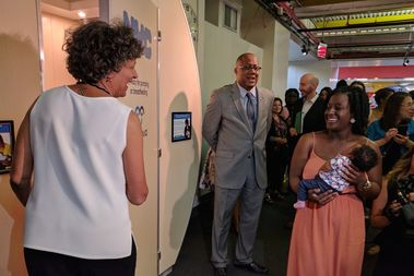 Health Commissioner Dr. Mary Bassett, left, welcomes new mom Chana Dawkins-Mason, right, and her one-month-old-baby Brielle into the city's new public lactation pod installed at the Brooklyn Children's Museum on Wednesday.